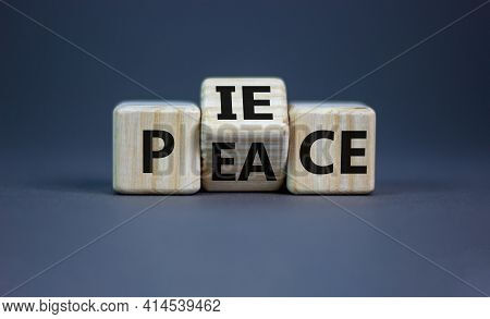 Piece Of Peace Symbol. Turned Cubes And Changed The Word 'piece' To 'peace'. Beautiful Grey Backgrou