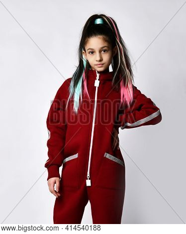 Pretty Caucasian Girl Model 10 Years Old With Fashionable Hairstyle Dressed In Sportswear Posing For