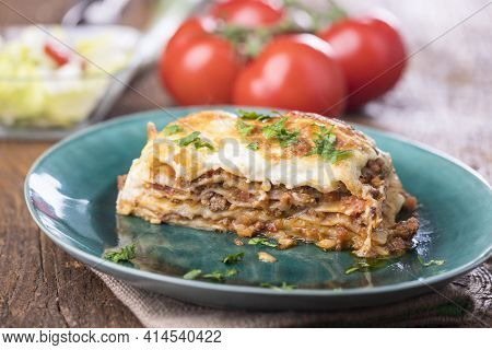 Portion Of Lasagna On A Green Plate