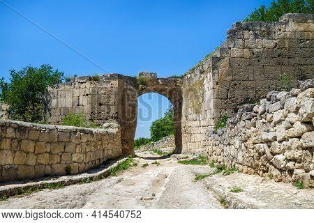 City Gates Inside Cave Fortress Chufut Kale, Bakhchisaray, Crimea. Bricks On Both Side Of Street Are