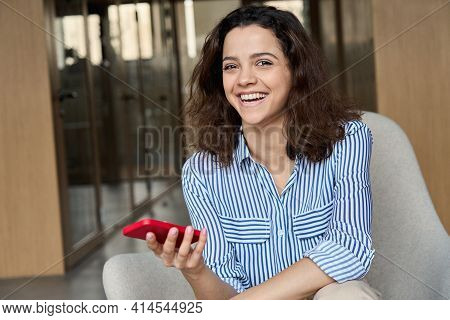 Happy Hispanic Young Woman Laughing Holding Smartphone, Portrait. Smiling Latin Teen Girl Student Ha