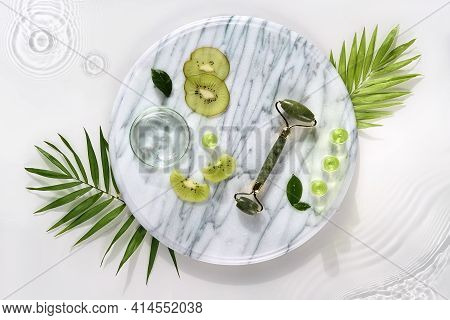 Cosmetic Skincare Background. Herbal Medicine With Kiwi Slices, Palm Leaves. Homemade Cosmetics On M