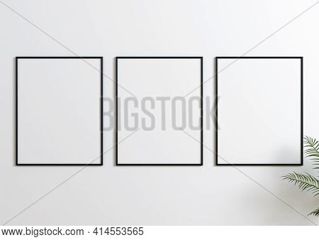 Triple Frame Mockup On Wooden Floor With Green Plant And White Wall Behind It. Triple Poster Mockup