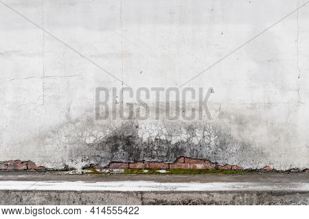 Abstract Grungy Interior, Concrete Floor And Old Red Brick Wall With Damaged White Stucco, Backgroun