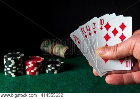 Poker Cards With Royal Flush Combination In The Game. Close-up Of A Gambler Hand Is Holding Playing