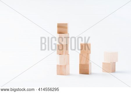 Wooden Cubes On A White Background For Use In Conceptual Texts.business Concept.copy Space. Place Fo