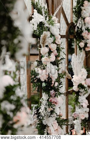 A Large Wooden Wedding Photo Zone Decorated With Flowers. Wooden Wedding Arch With Windows. Wedding