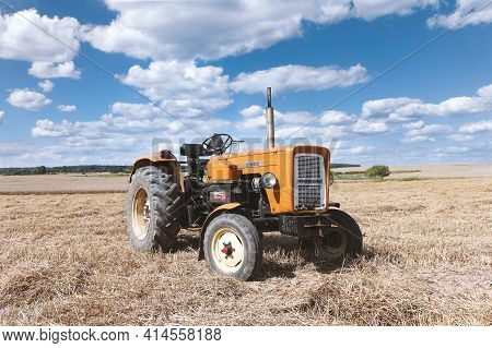 Rokitno, Poland - August 7, 2017. Old Ursus C-360 Tractor In A Stubble Field During Summer Harvest