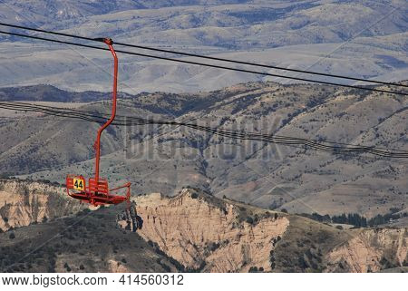 Red Chairlift With Number 44 In Uzbekistan In Pamir Mountains