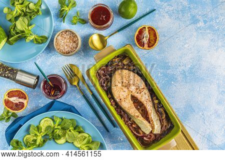 Baked Salmon Steak With Mushroom, Onion And Spices Served With Ingredients On Light Blue Table Surfa