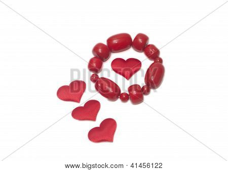 Female Bracelet And Four Red Heards On White Background Valentine's Day
