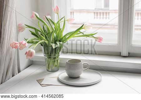 Easter Spring Still Life. Cup Of Coffee And Floral Bouquet On Window Sill. Pink Tulips Flowers In Ce