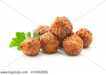 Fried meatballs with a parsley leaf isolated on white background