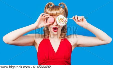 Sexy Girl With Lollipop And Macaroons. Young Woman Covering Eyes By Colourful Candy And Macaroon.