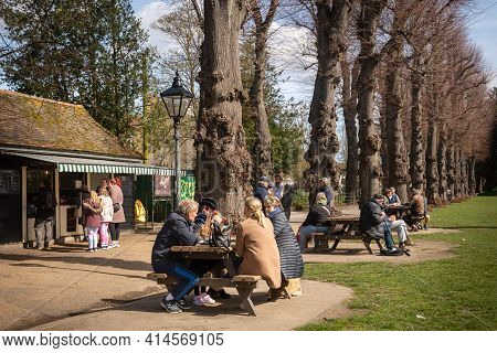 Canterbury, Kent, England - Mar 27 2021: People Sit Outside Don Juan Cafe And Enjoy A Bright Spring