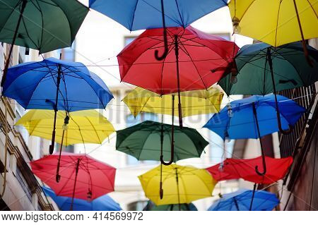 Colorful Umbrellas Hanging Over Narrow Street Of Old Town, Istanbul, Turkey. Urban Street Decor. Tra