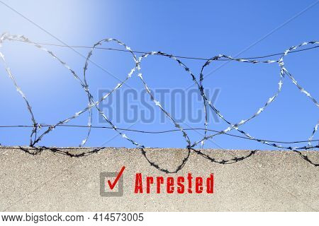 A Label Has Been Set About The Detention Of The Offender. The Inscription Is Arrested On The Wall Wi