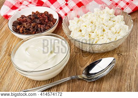 Checkered Napkin, Transparent Glass Bowl With Cottage Cheese, Bowl With Raisin, Spoon, Bowl With Sou