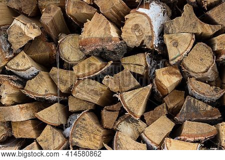 Wooden Background. Firewood For The Winter, Stacks, Wood Texture. Fuel. Preparation Of Firewood For