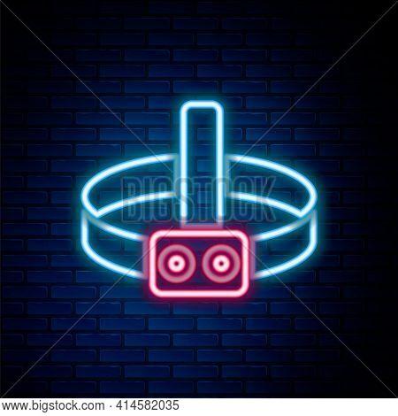Glowing Neon Line Head Flashlight Icon Isolated On Brick Wall Background. Tourist Head Flashlight. C