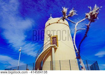 Carbonera Lighthouse Located On Punta Mala, La Alcaidesa, Spain. Lantern Overlooks The Strait Of Gib