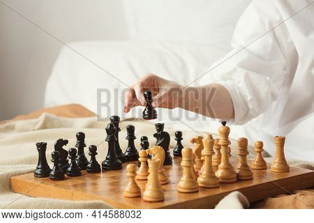 Chess Player Woman Learns Chess Opening By Playing With Himself. Black Pawn One Step Forward. Chess