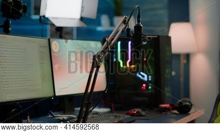 Game Is Over On Display Of Rgb Professional Powerful Computer In Empty Room