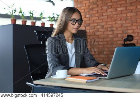 Beautiful Business Woman Working On Laptop In The Office