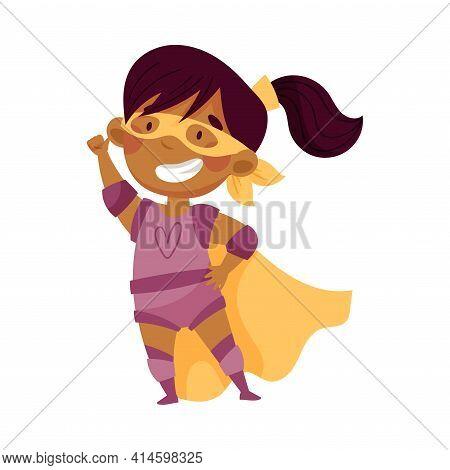 Little African American Girl Wearing Costume Of Superhero Pretending Having Power For Fighting Crime