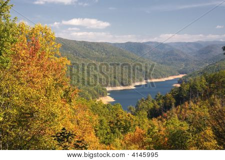 Lake And Mountains In Autumn
