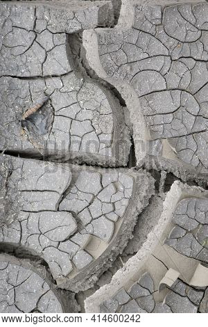Background Of Cracks In The Soil Drought, Ecology. Dry Cracked Ground Texture. Desert Background. Gl
