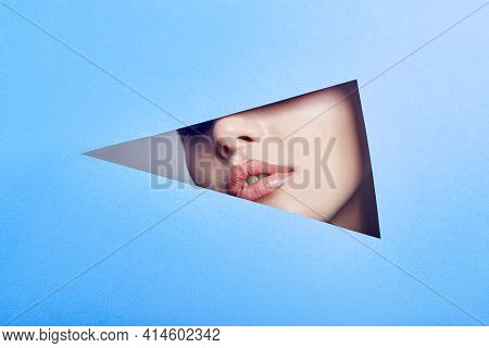 Woman Looking In The Hole, Bright Beautiful Makeup, Big Eyes And Lips, Bright Lipstick, Professional