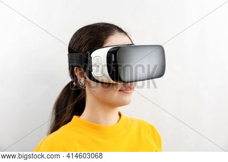 Three-quarter Portrait Close-up Of A Young Woman Wearing Virtual Reality Glasses. White Background.