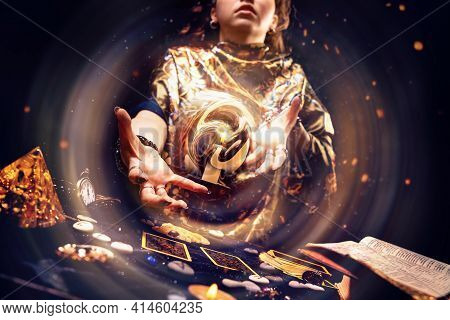 Magic. A Witch Conjuring A Magic Energy Ball With Her Hands. The Concept Of Astrology And Esotericis