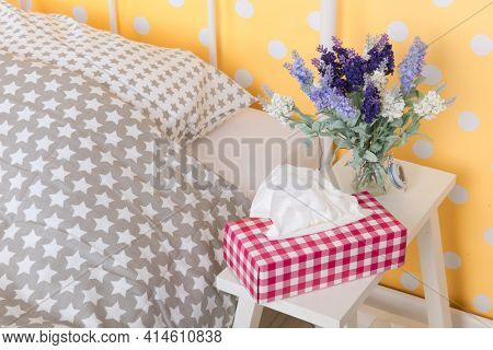 Bedroom with tissues and flowers