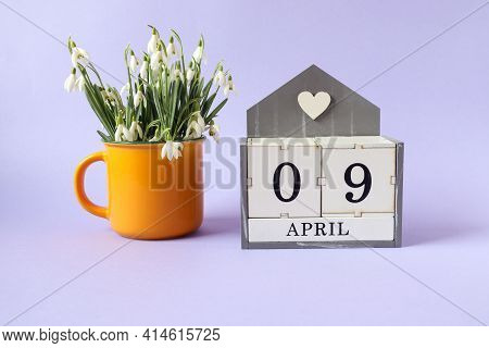 Calendar For April 9: Cubes With The Numbers 0 And 9, The Name Of The Month Of April In English, A B