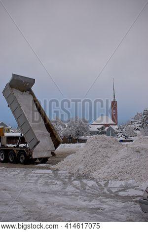Truck Is Unloading A Lot Of Snow On A Heap In Buchs In Switzerland 15.1.2021