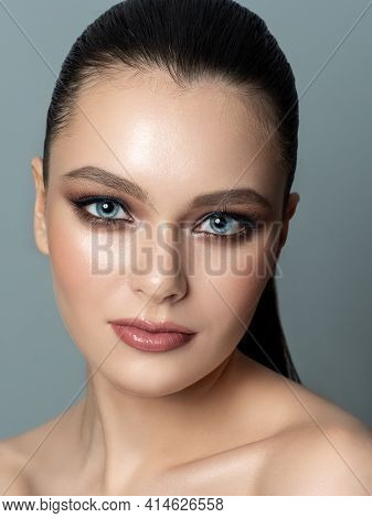 Beauty Portrait Of Young Woman With Perfect Skin. Skin Treatment And Youth Makeup Concept