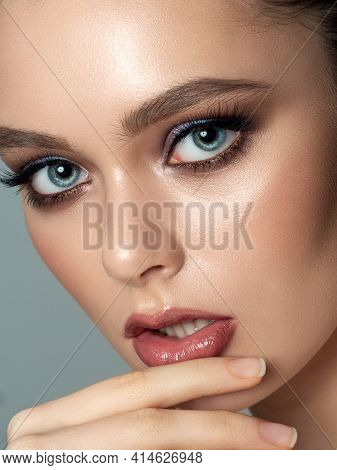 Close Up Portrait Of Young Beautiful Woman Touching Her Lip