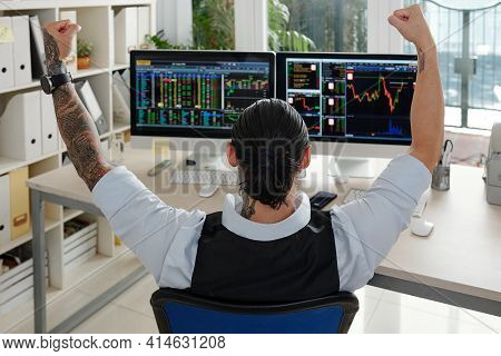 Excited Male Trader With Ponytail Raising Hands When Celebrating Companies Stock Price Increased, Vi