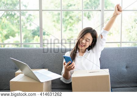 Happy Young Asian Woman Entrepreneur, Smile For Sales Success After Checking Order From Online Shopp