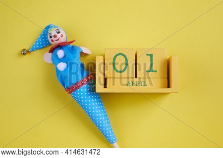 April Fools Day Background. Numbers Cube With Clown On Yellow Background