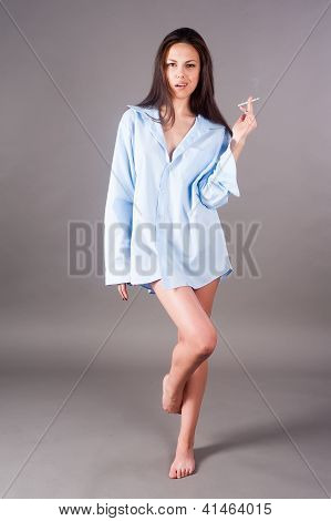 beautiful young brunette woman with cigarette