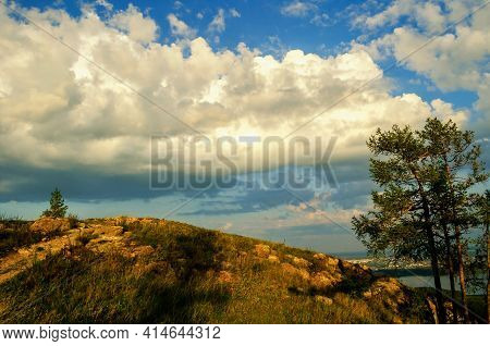Mountain landscape,mountain sunset.Summer sunset mountain landscape,clouds over the Sugomak mountain in Southern Urals, Russia.Ural mountains,mountain view.Mountain landscape,mountain background