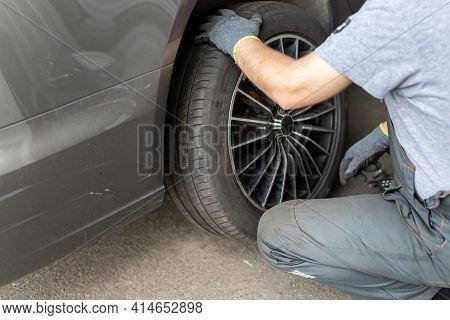 Car Wheel Repair Shop Outdoor Ground . Seasonal Winter Tyre Change At Workshop. Vehicle Tire Repair,