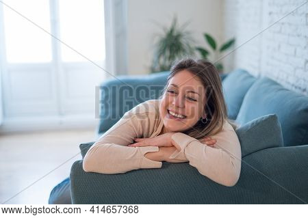 Beautiful Lifestyle Portrait Of Young Woman Happy And Relaxed At Home
