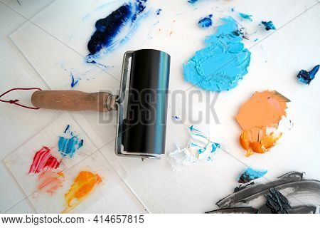 Detail Of Paint Brushes And Bright Paint In An Artist's Studio