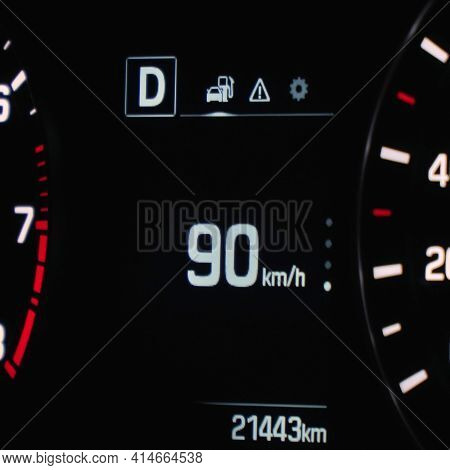 Speedometer In The Car On The Dashboard. The Cars Speedometer Shows 90 Mph