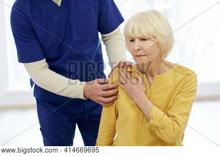 Physiotherapist Treatment Patient. Chiropractor Holds Patients Hand, Shoulder Joint Treatment