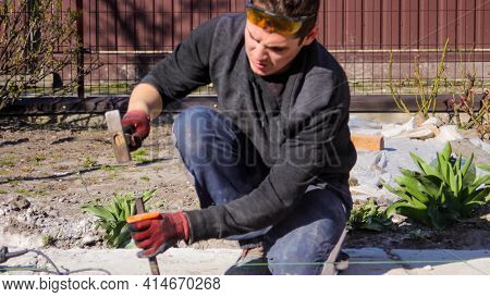 Defocus Young Construction Worker With Wrinkled Forehead In Yellow Glasses Removing Irregularities O